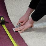 cutting and measuring the carpet